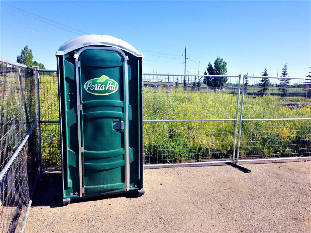 Construction Site Safety Fencing around Portapotty